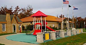 photo of roadside welcome center with brightly colored playground
