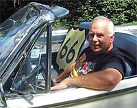 photo of steve rider sitting in a vintage convertible